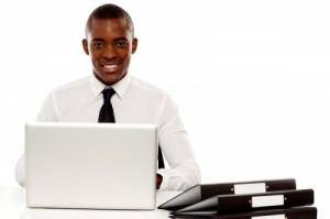 Male exec smiling at desk