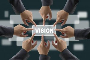 Vision - many hands pointing to one vision