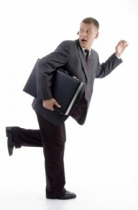 Businessman with briefcase running in fear